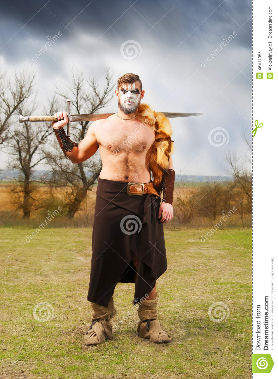 Portrait of a muscular ancient warrior with a sword
