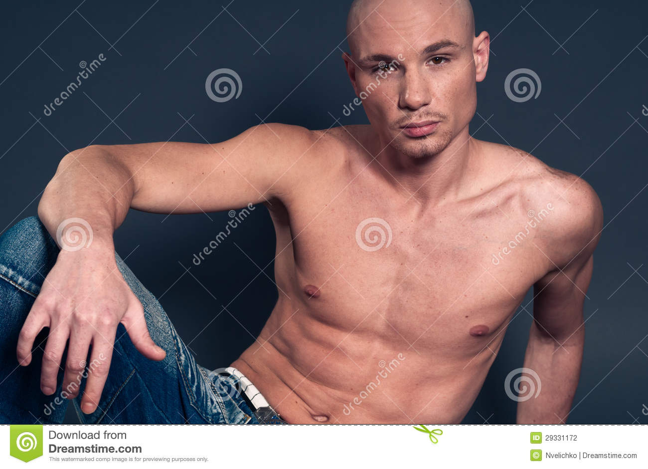 Muscular Young Man Shirtless Against The Sky Stock Photo