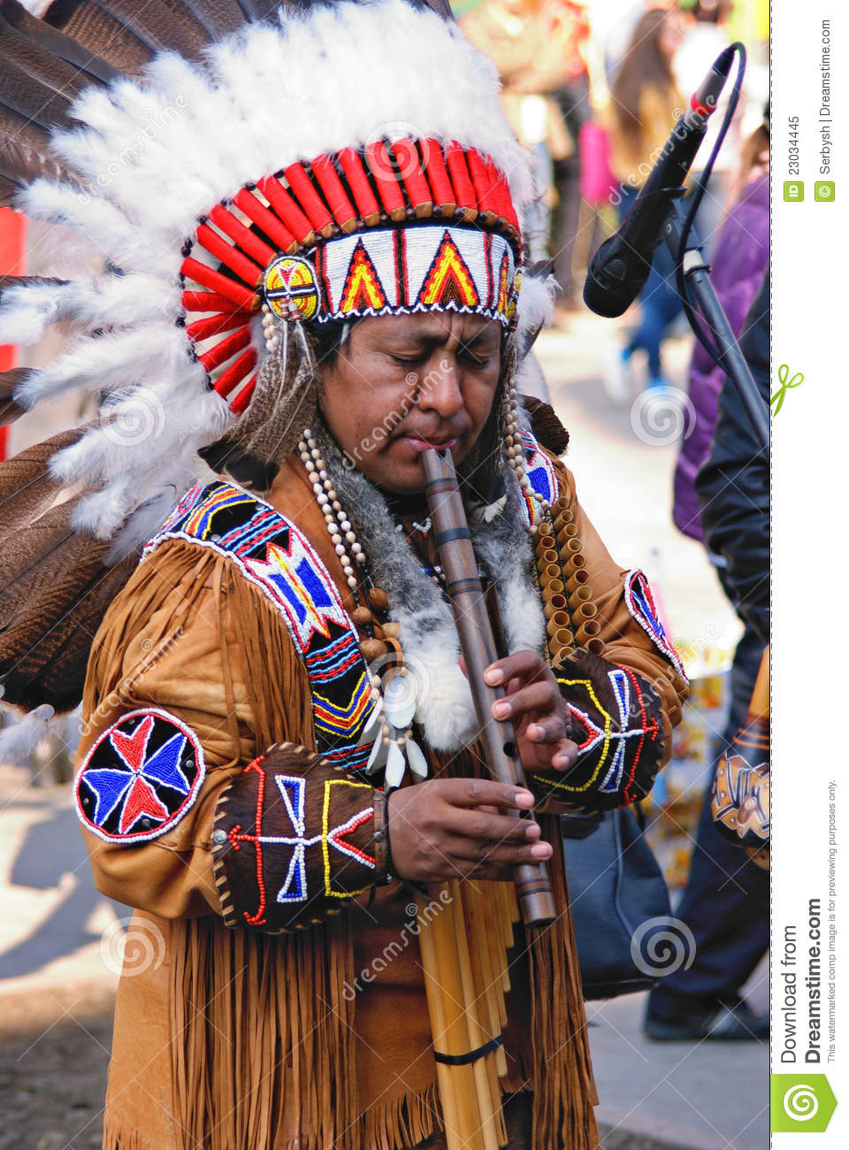 Portrait Of A Native American Playing At A Flute Editorial