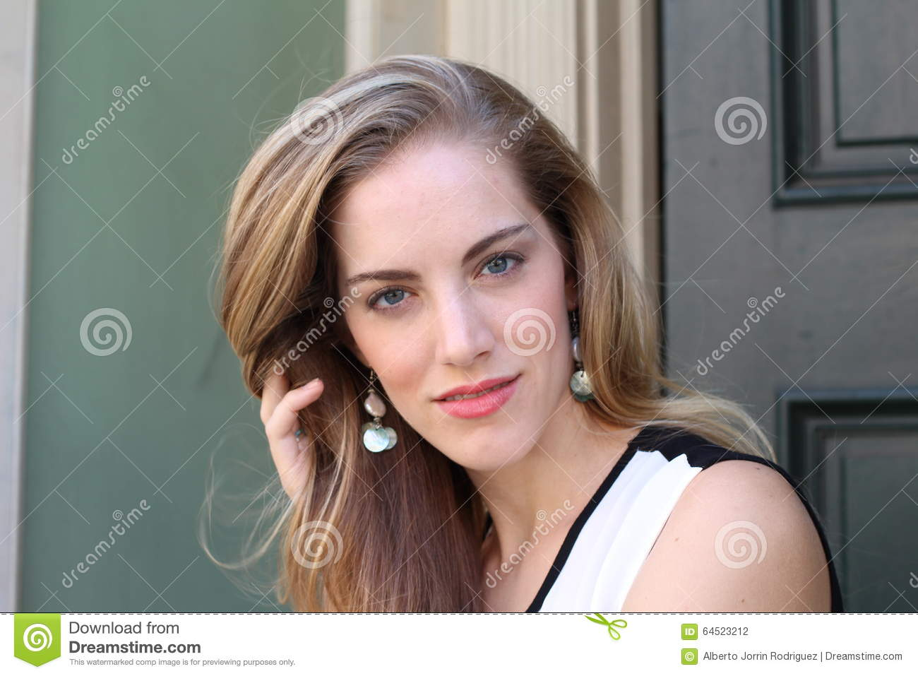 Portrait Of Naturally Beautiful Woman In Her Twenties With Blond