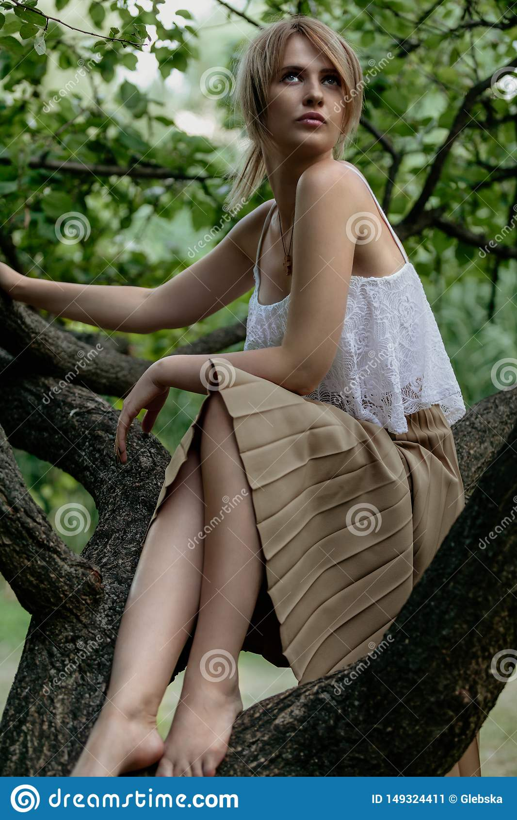 https://thumbs.dreamstime.com/z/portrait-nature-slender-barefoot-girl-white-top-sitting-tree-branch-summer-day-cute-blonde-sits-149324411.jpg