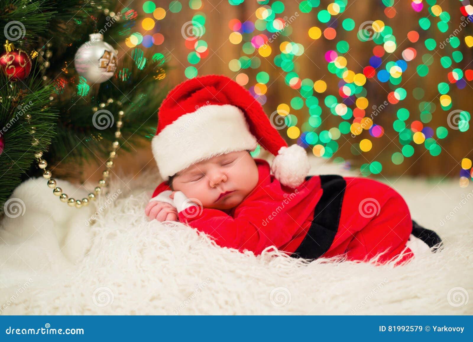5d7426d79b96 Portrait Of Newborn Baby In Santa Clothes Lying Under Christmas Tree ...