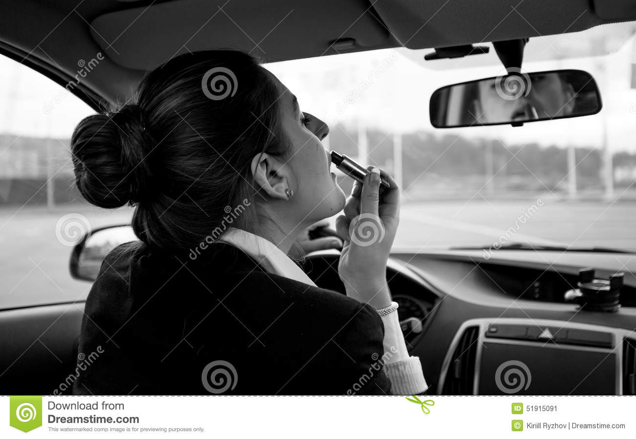 image stock black and white portrait of woman applying lipstick in car image 51915091. Black Bedroom Furniture Sets. Home Design Ideas