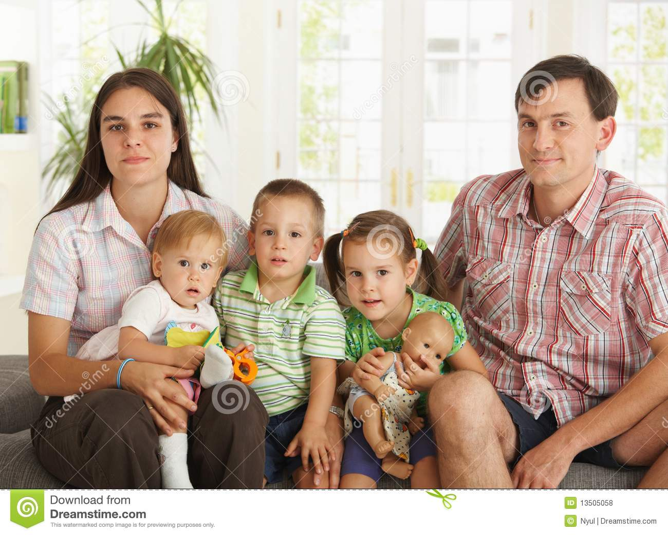 Portrait Of Nuclear Family At Home Stock Photo Image
