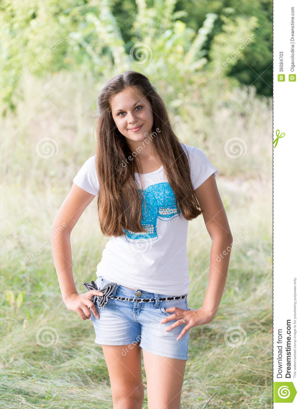 14 Year Old Girl Sitting Crossed Legged On Her Bed Stock: Portrait Ofa Girl 14 Years In Nature Stock Image