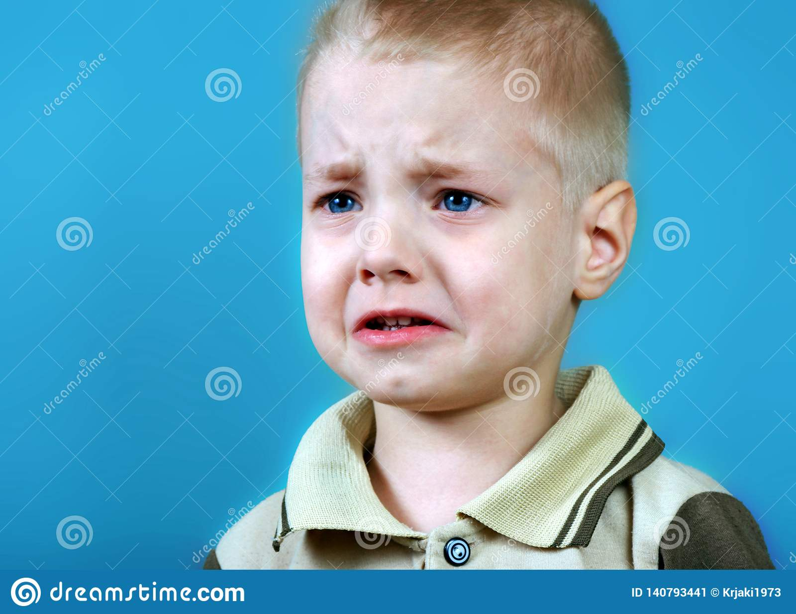 Portrait of offended little boy sad crying boy resentment emotion