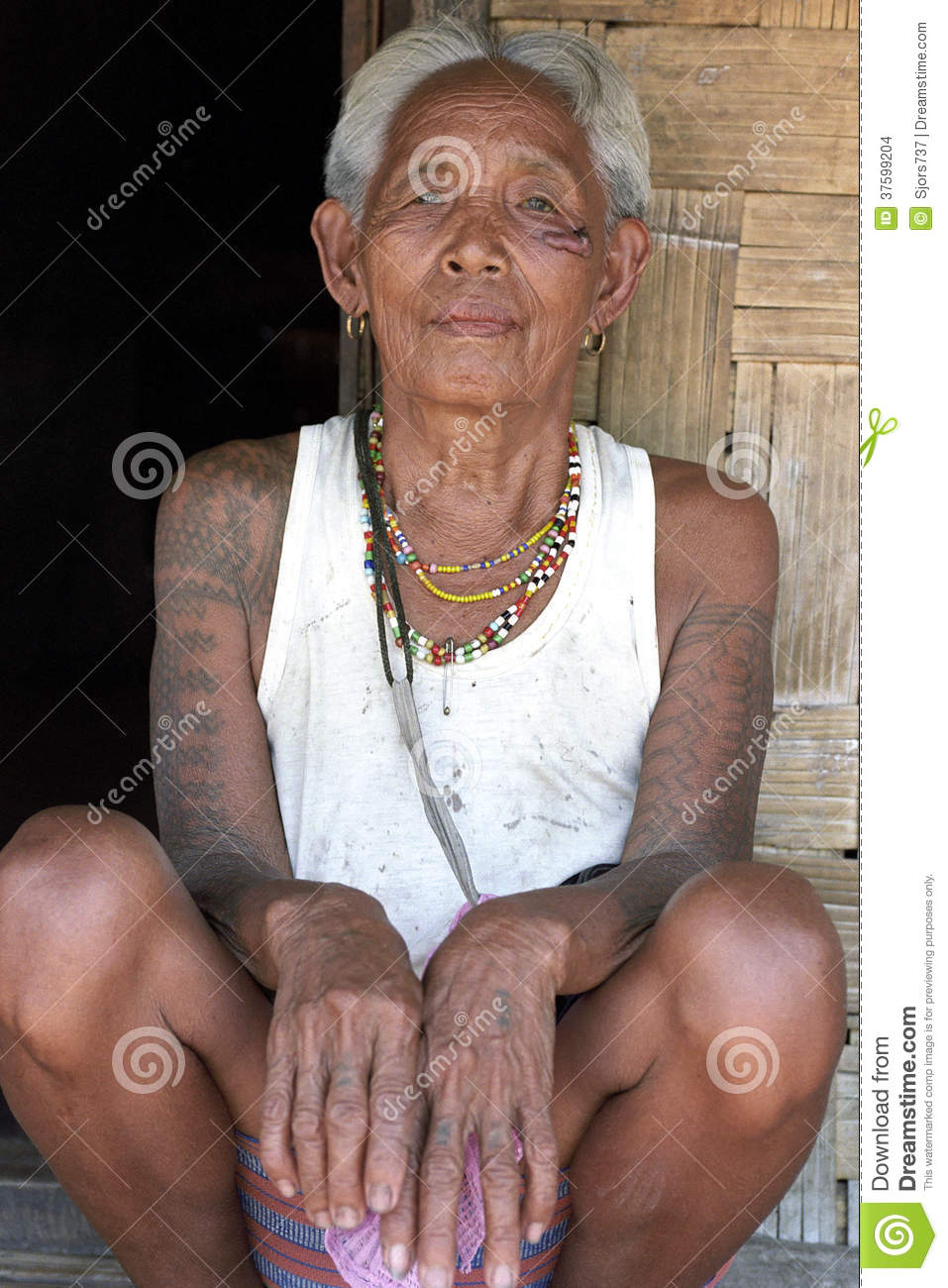 Portrait of old filipino woman with tattoos editorial stock image