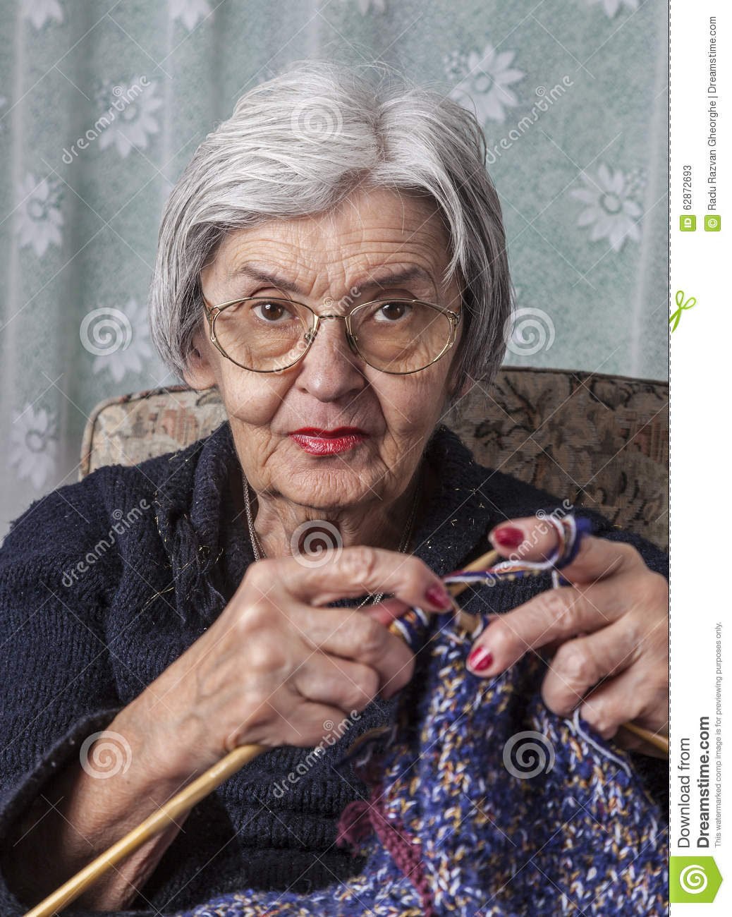 Old Knitting Woman : Portrait of an old woman knitting stock photo image