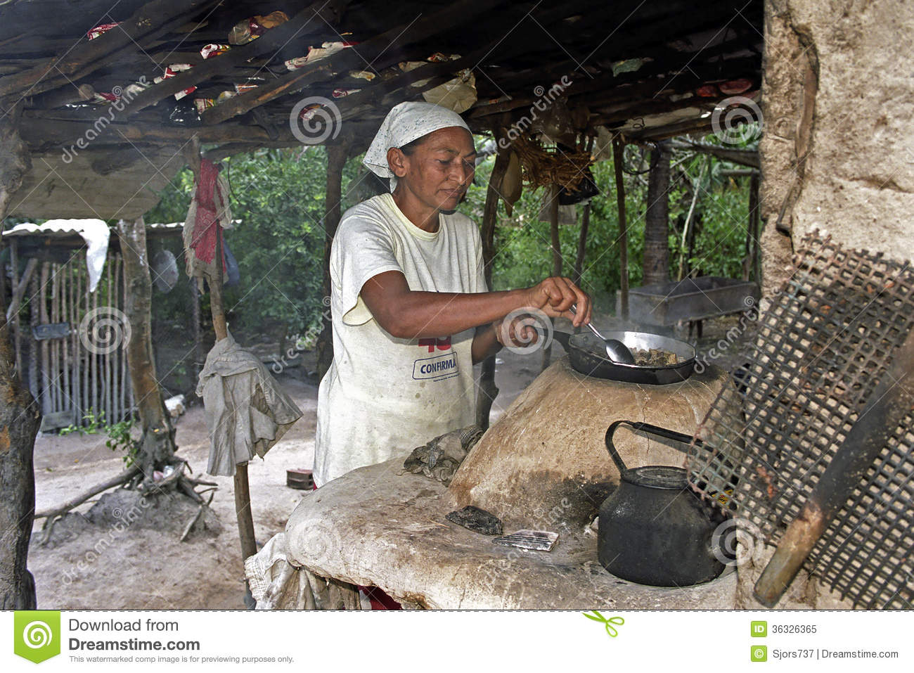 Portrait Of Outdoor Cooking Senior Woman Brazil Editorial