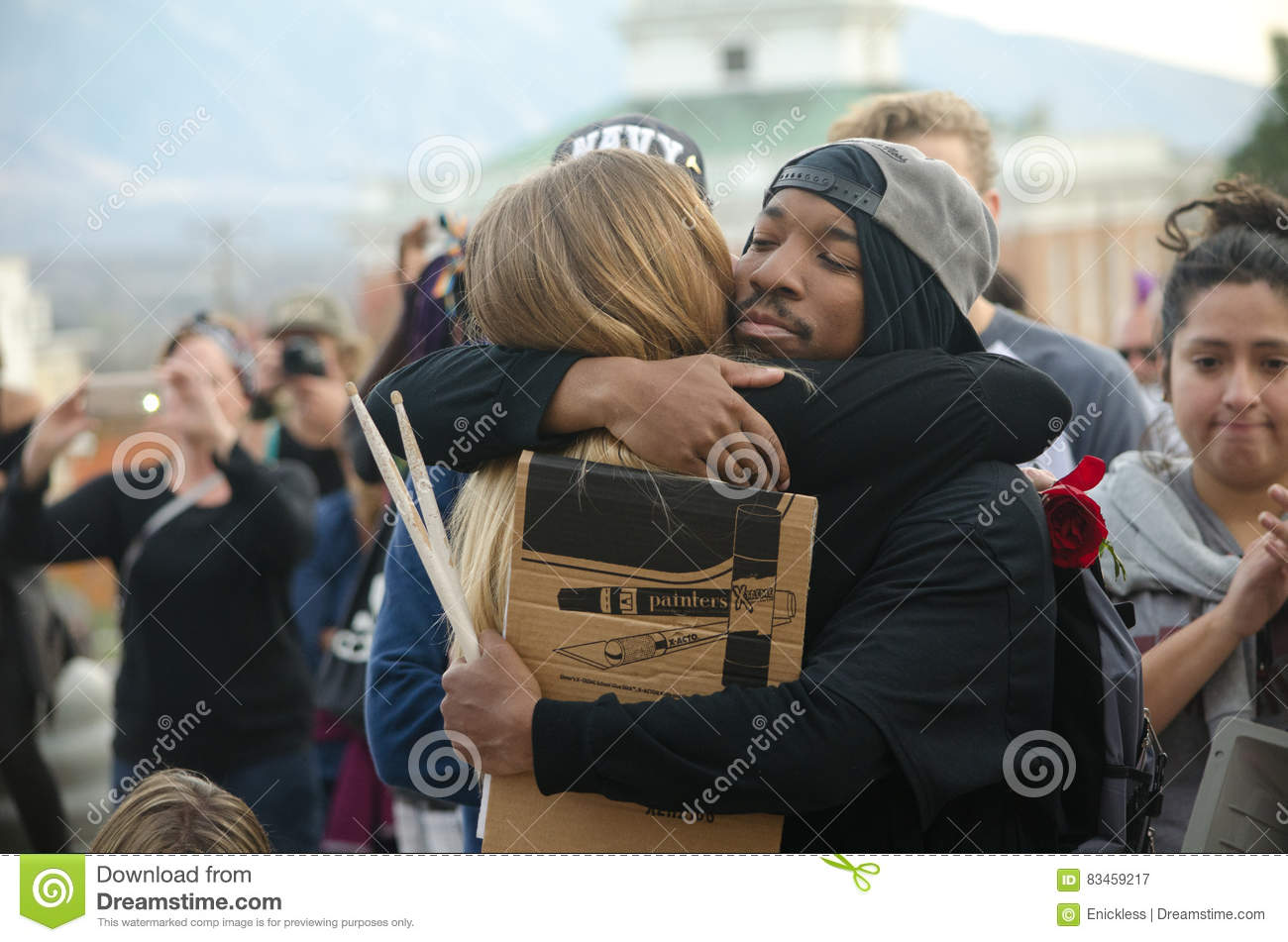 portrait of people hugging at trump protest editorial photography