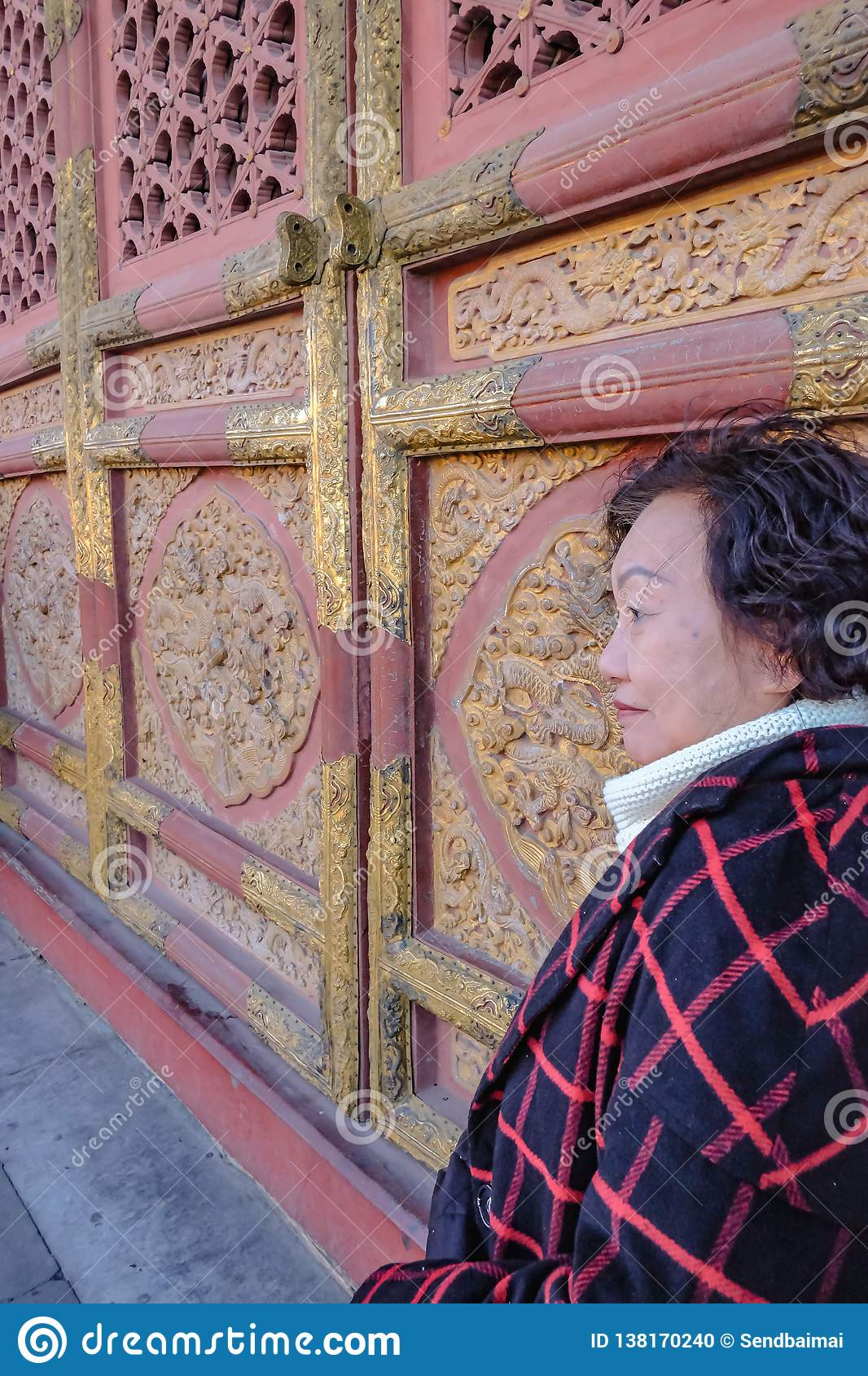Portrait photo of Senior asian women in the Forbidden Palace Gate at beijing