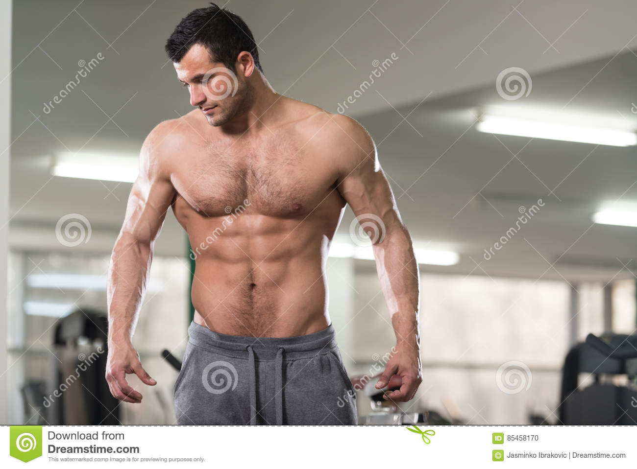 fat hairy people nude - Portrait Of A Physically Fit Muscular Hairy Man. Hairy Handsome Young Man  Standing Strong In