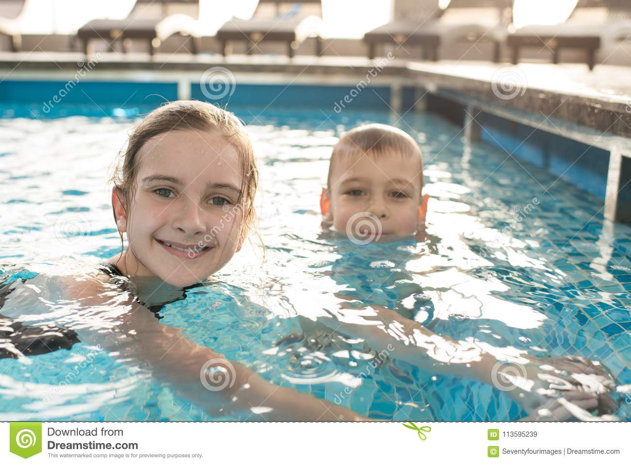 Happy children swimming in pool