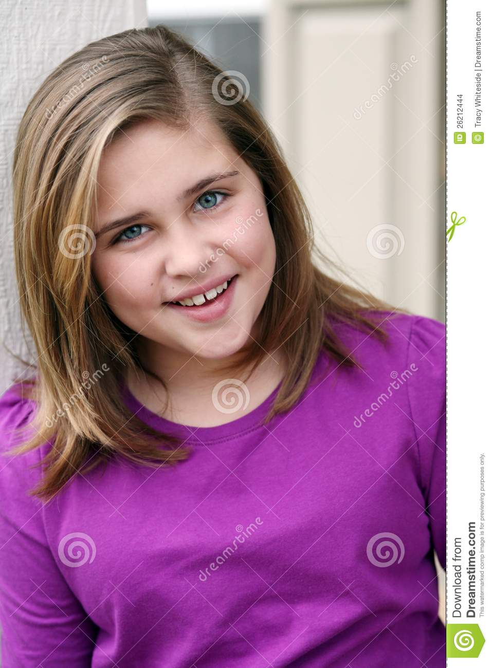 Headshot of preteen caucasian girl smiling.