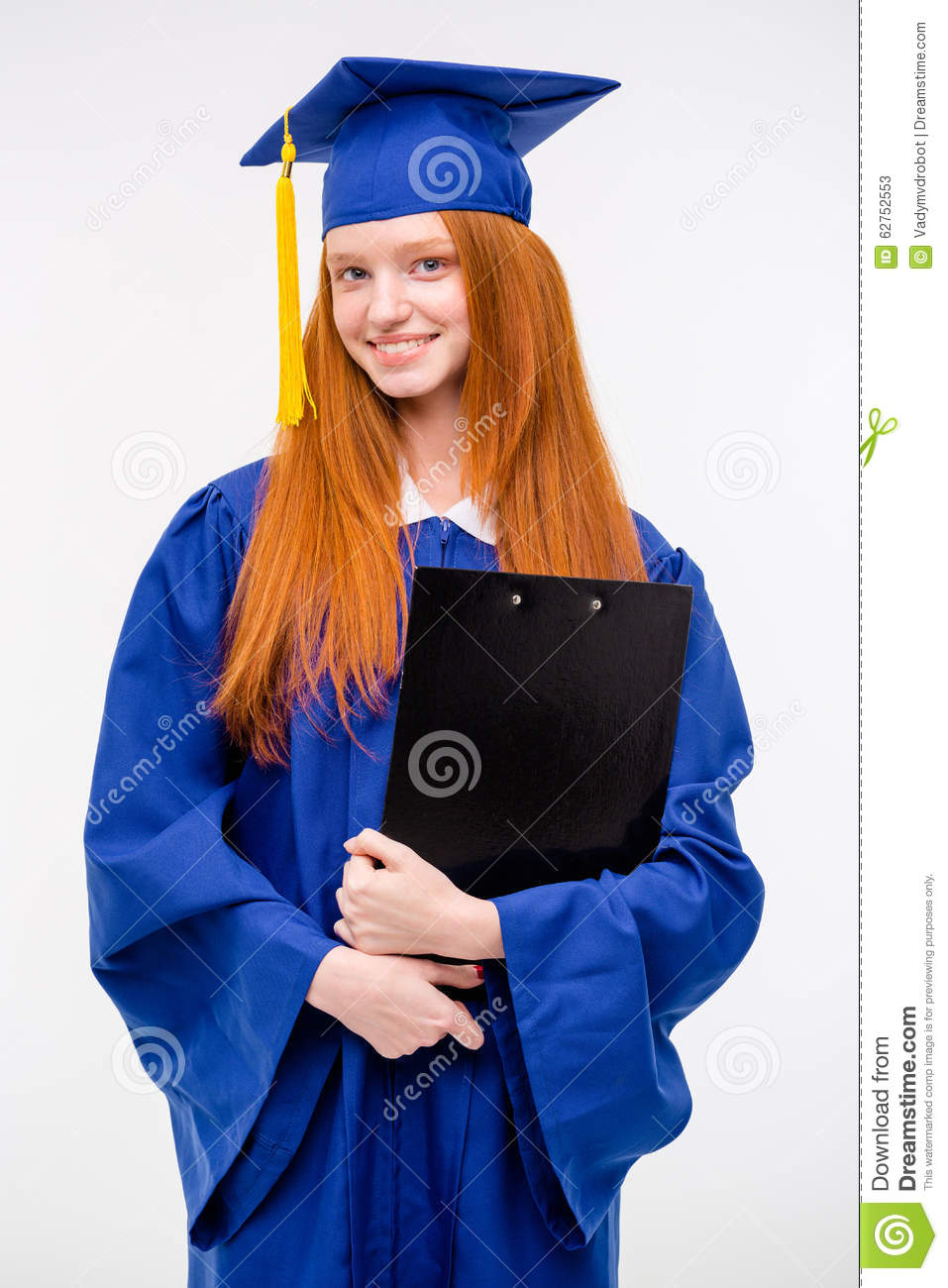 Portrait Of Pretty Cheerful Girl In Gown And Graduation Cap Stock ...