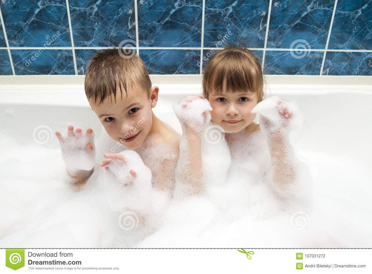 Portrait of pretty children little girl and boy in bath. Hygiene