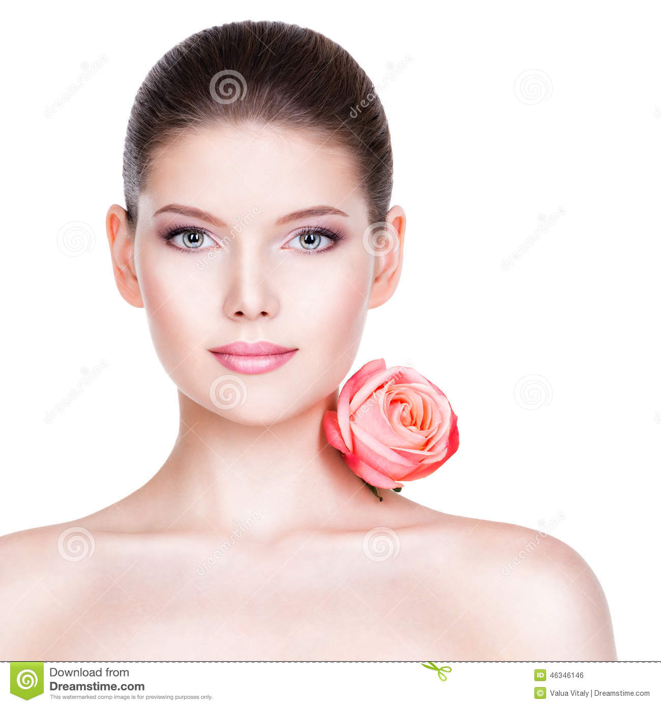 Portrait of pretty face of beautiful woman with a pink rose.