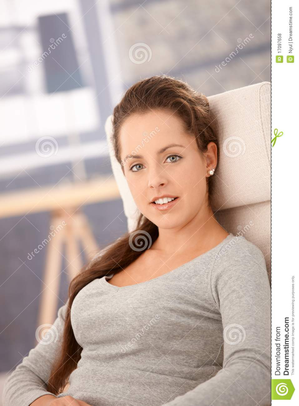 Portrait Of Pretty Girl Relaxing At Home Smiling Stock