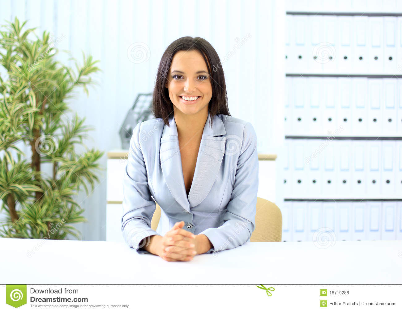 Portrait Of Pretty Girl Sitting At Desk Royalty Free Stock