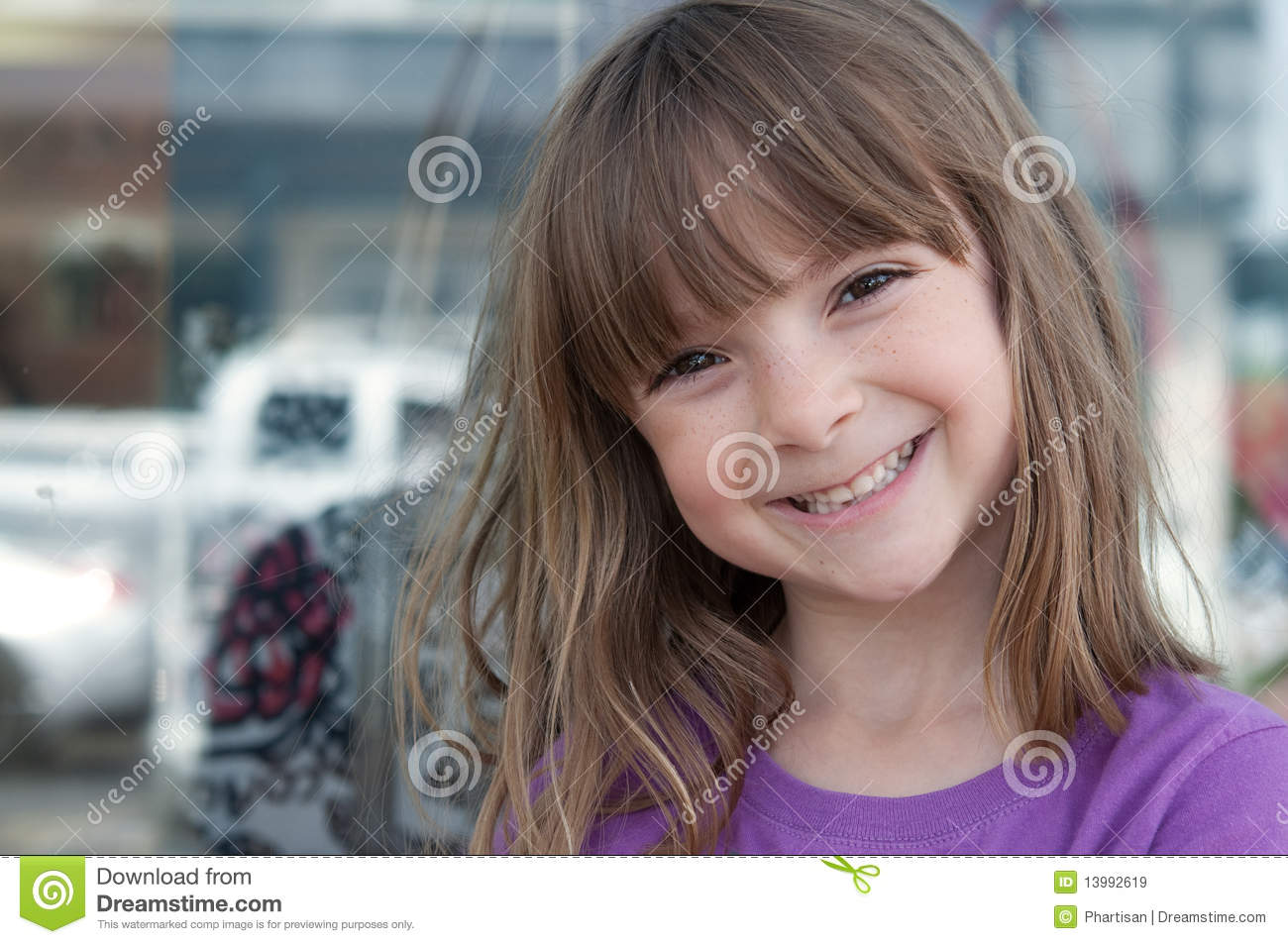 Portrait of a pretty little girl with bright smil