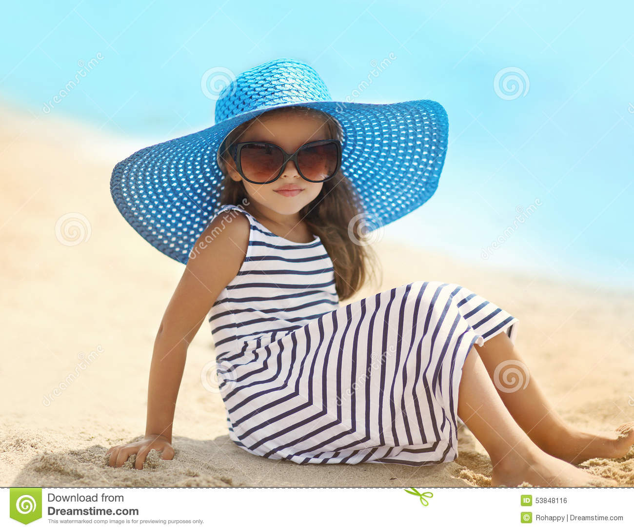 Portrait Of Pretty Little Girl In A Striped Dress And Straw Hat ... 79c96e91aa3