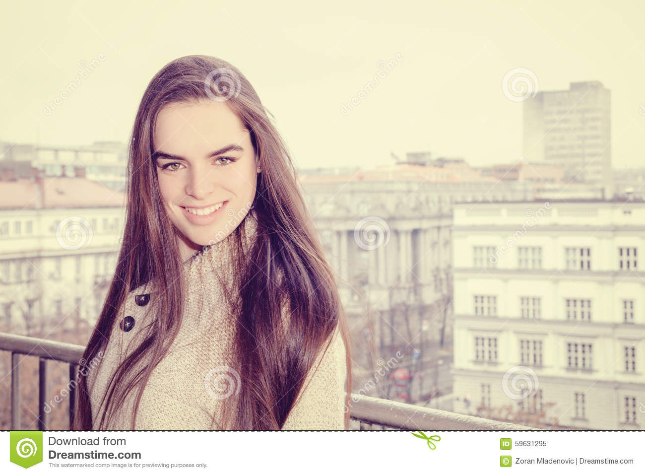 Portrait of pretty woman smiling in city background
