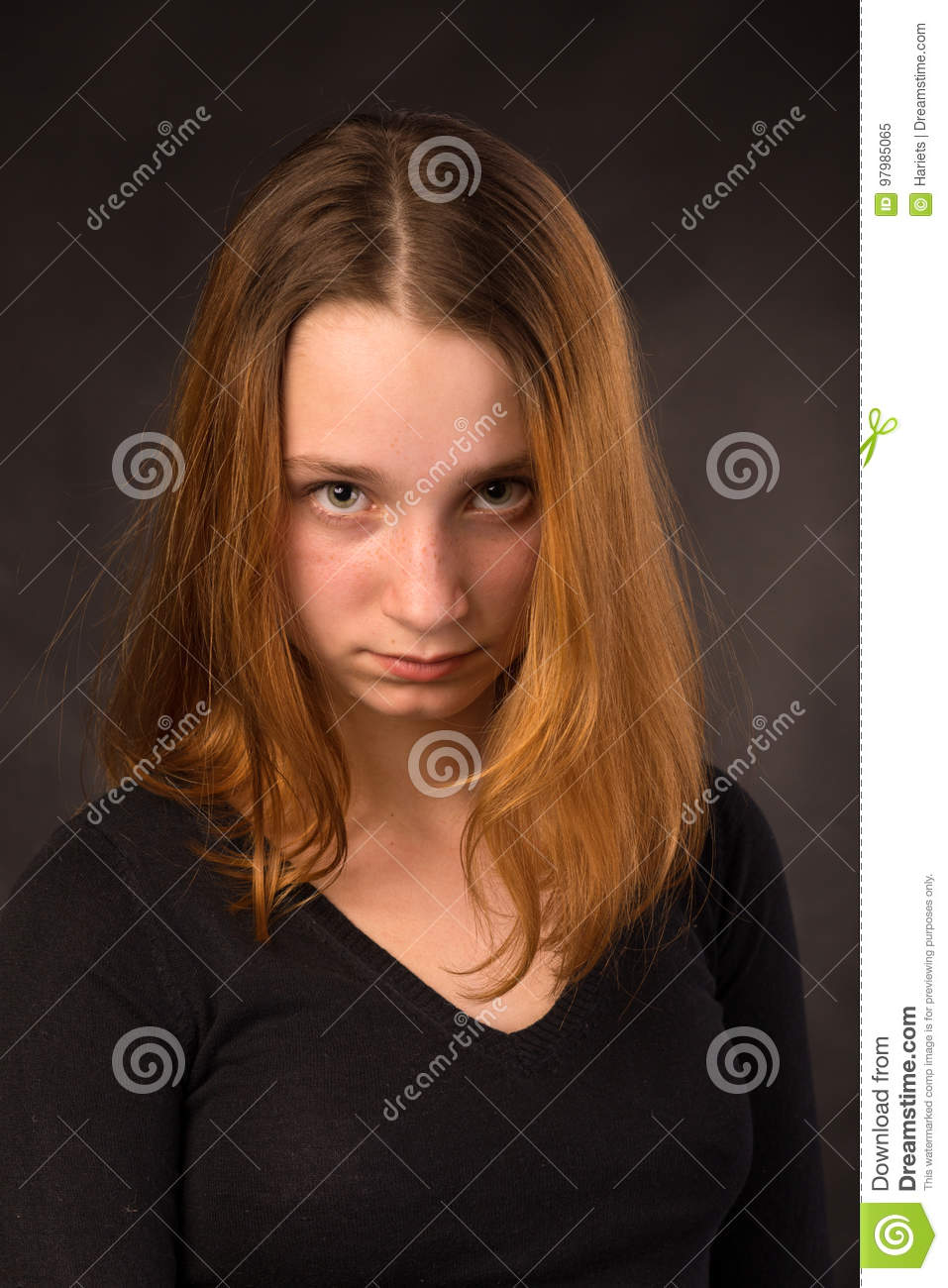 Portrait of a pretty young Frowning redhead girl