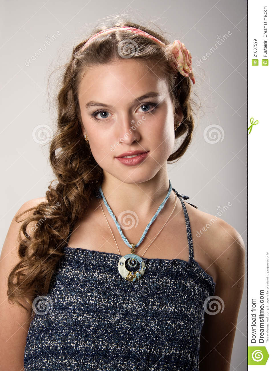 Portrait of a pretty young girl with long hair