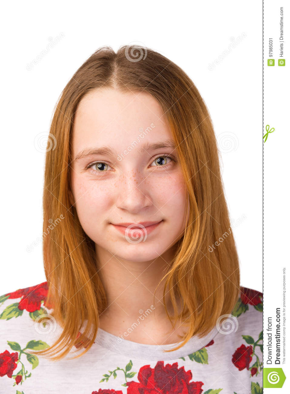Portrait of a pretty young smiling redhead girl