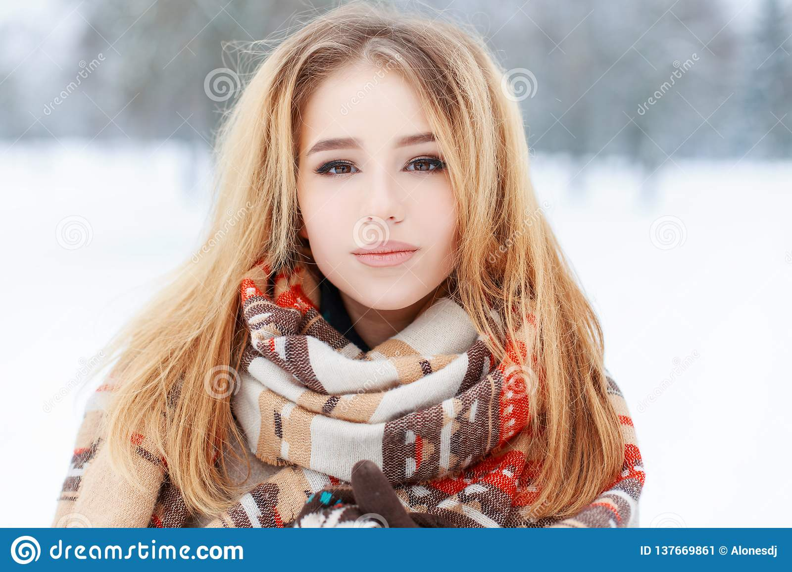 Portrait Of A Pretty Young Woman With Brown Eyes With Beautiful