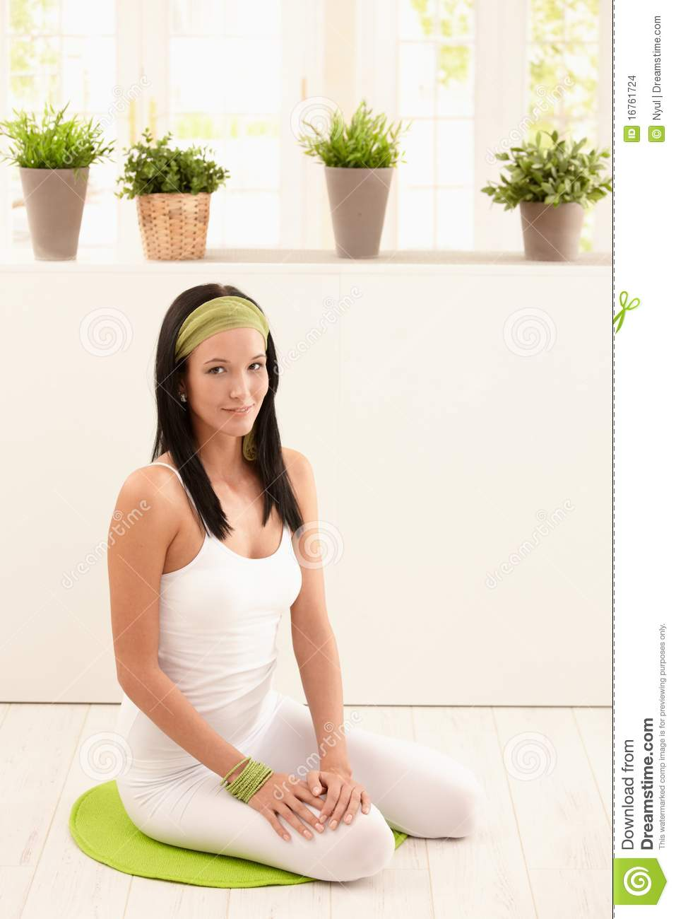 Portrait Of Pretty Young Woman On Floor Stock Photo ...