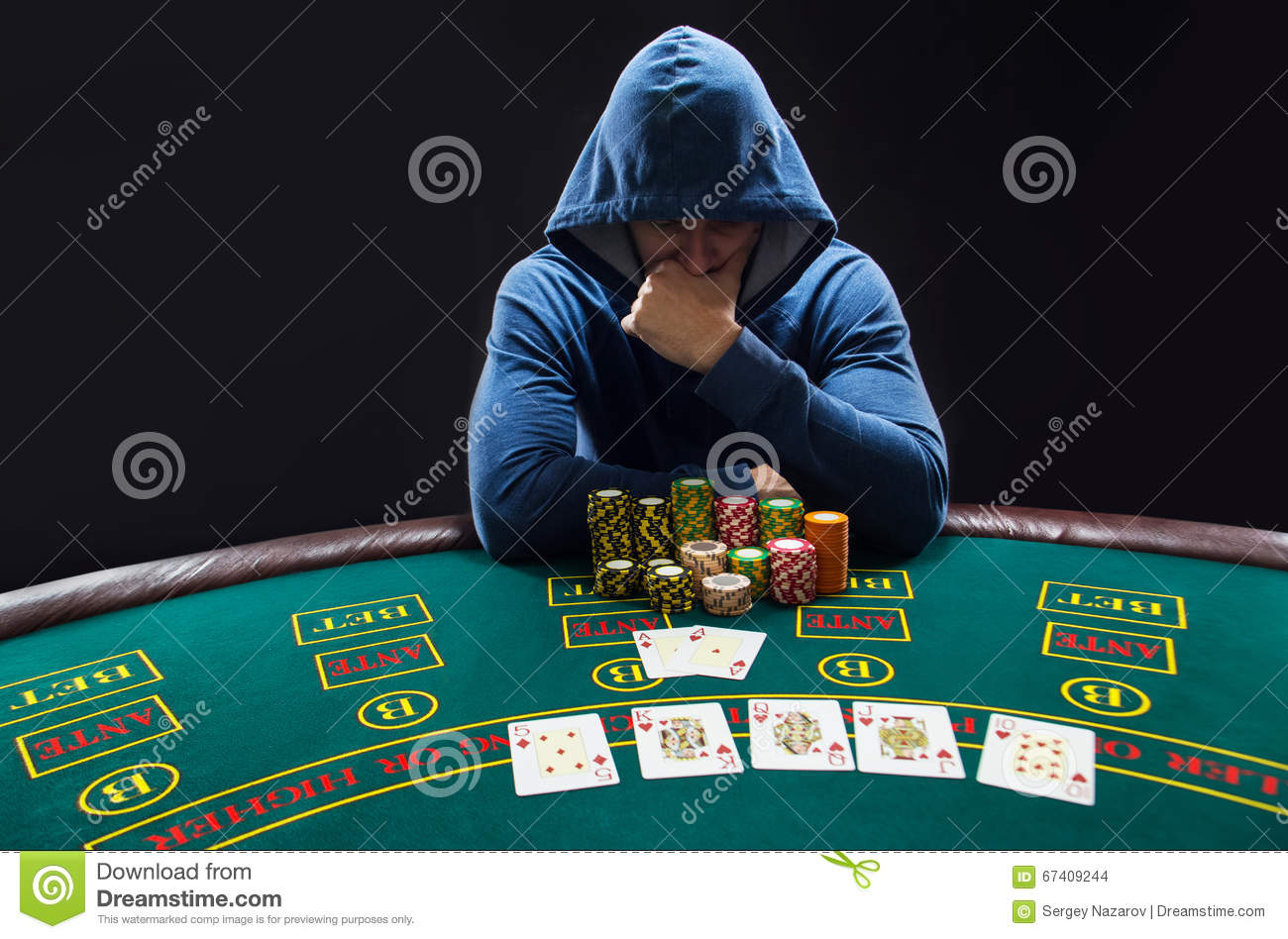 portrait of a professional poker player sitting at pokers. Black Bedroom Furniture Sets. Home Design Ideas