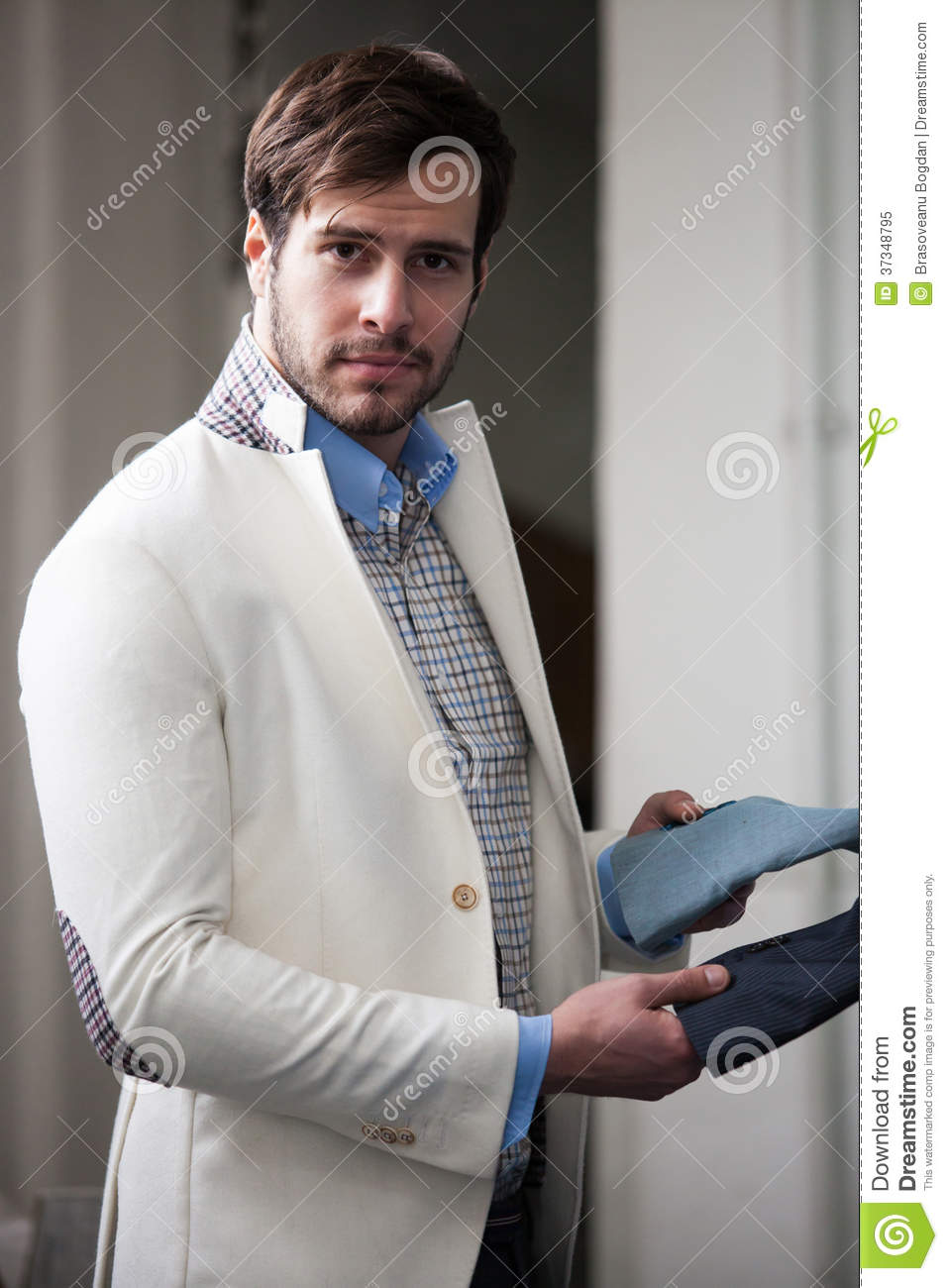 Portrait in profile of a handsome young man at the store