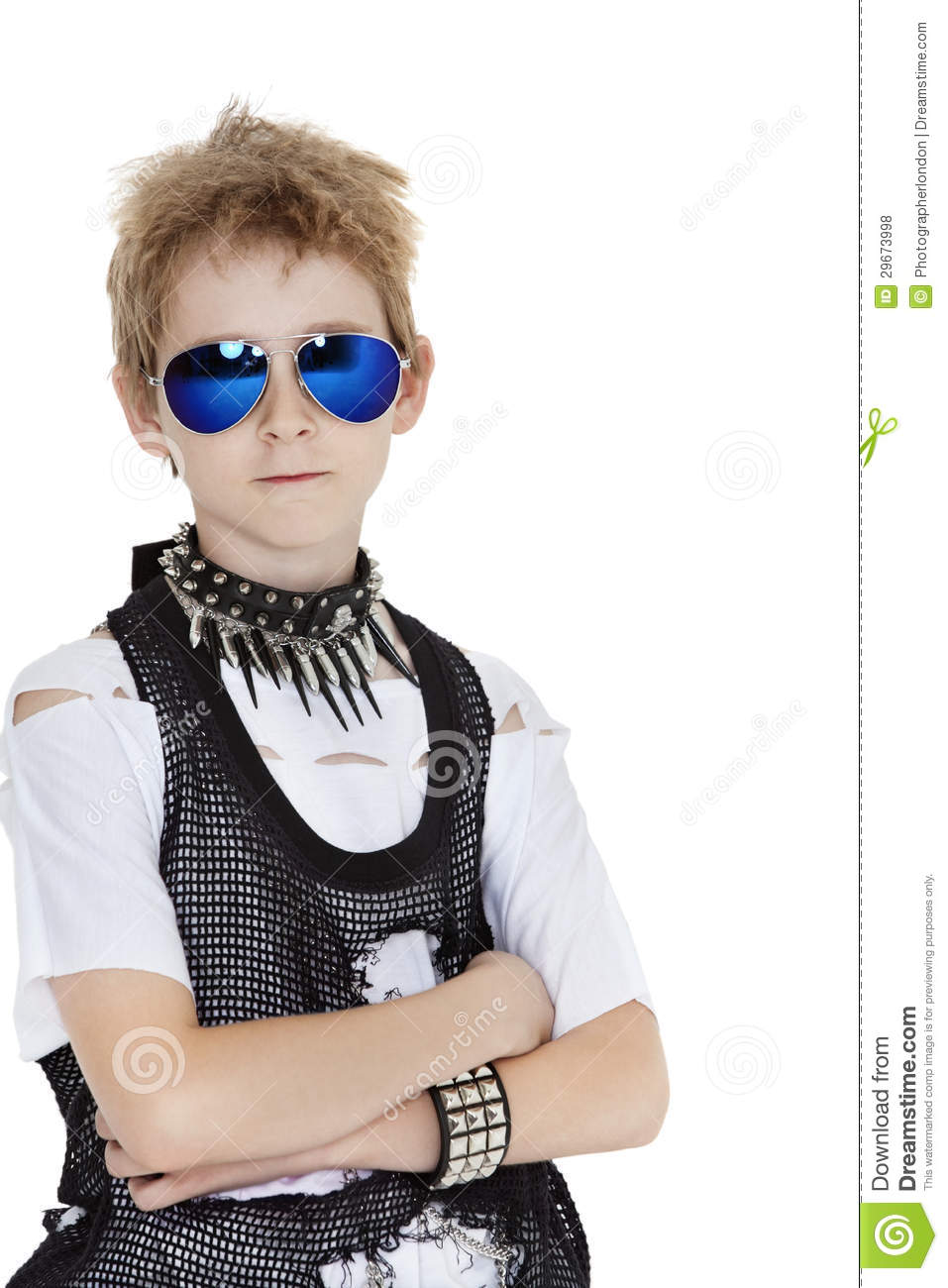 Portrait Of Punk Pre Teen Boy Wearing Sunglasses With Arms
