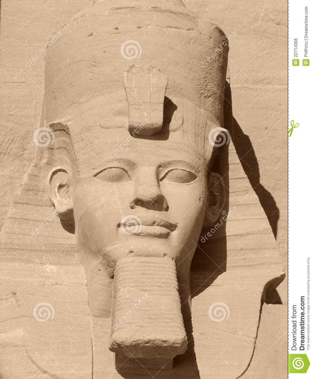 Sunny detail of a ancient stone sculpture showing Ramses 2nd in Egypt.