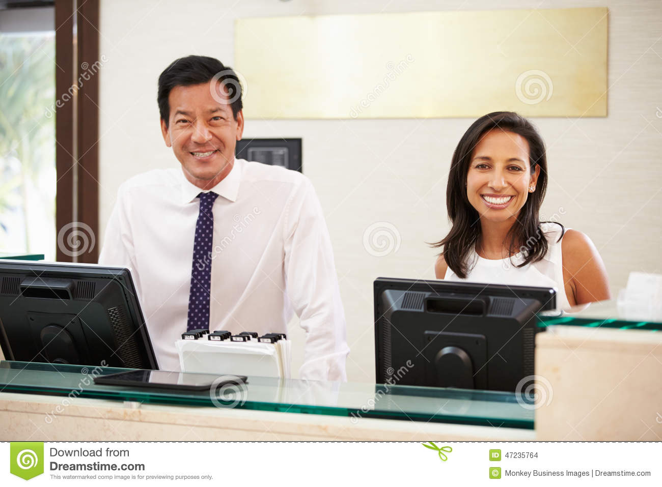 portrait of reception staff at hotel front desk stock photo portrait of reception staff at hotel front desk