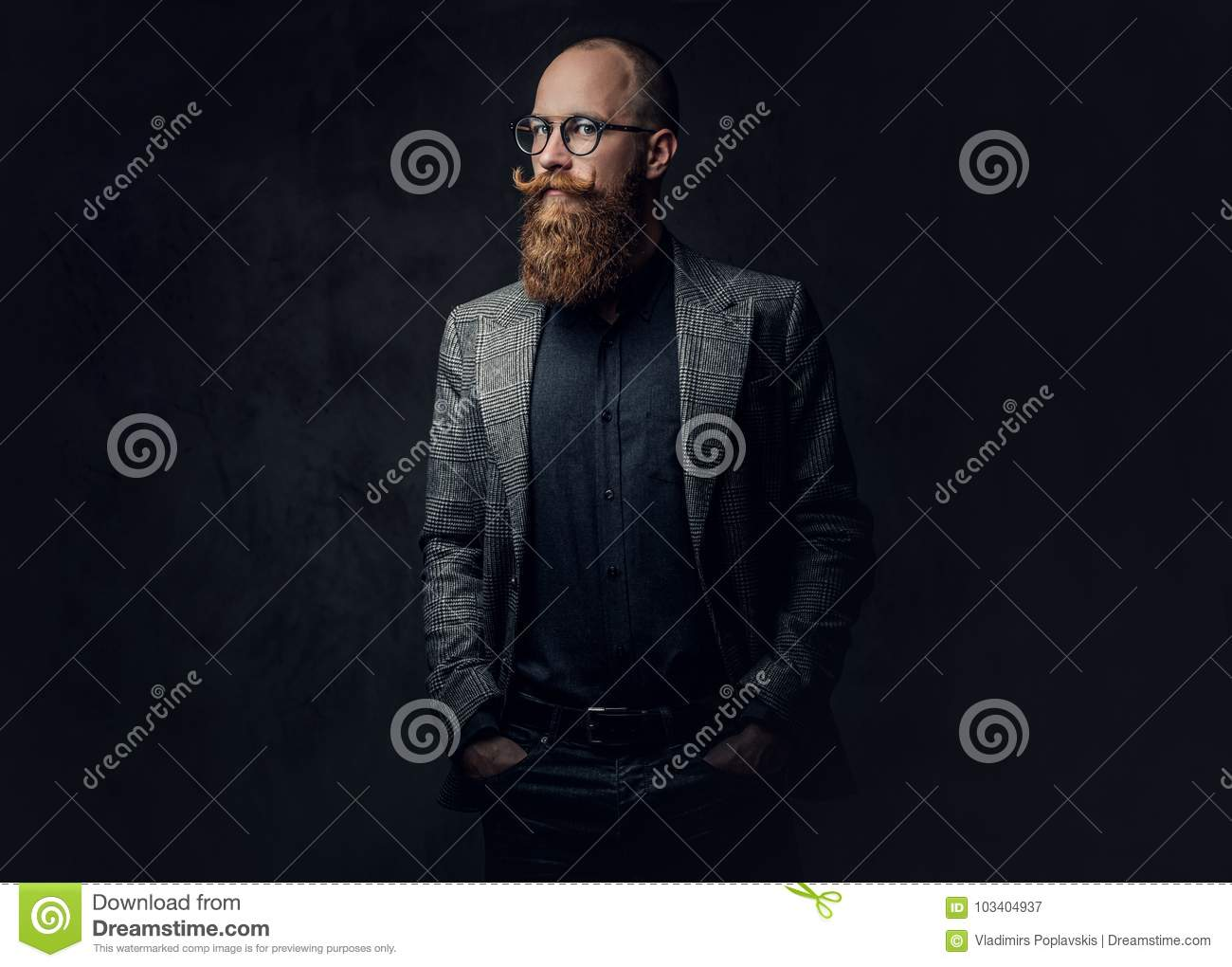 Redhead bearded male in a suit.