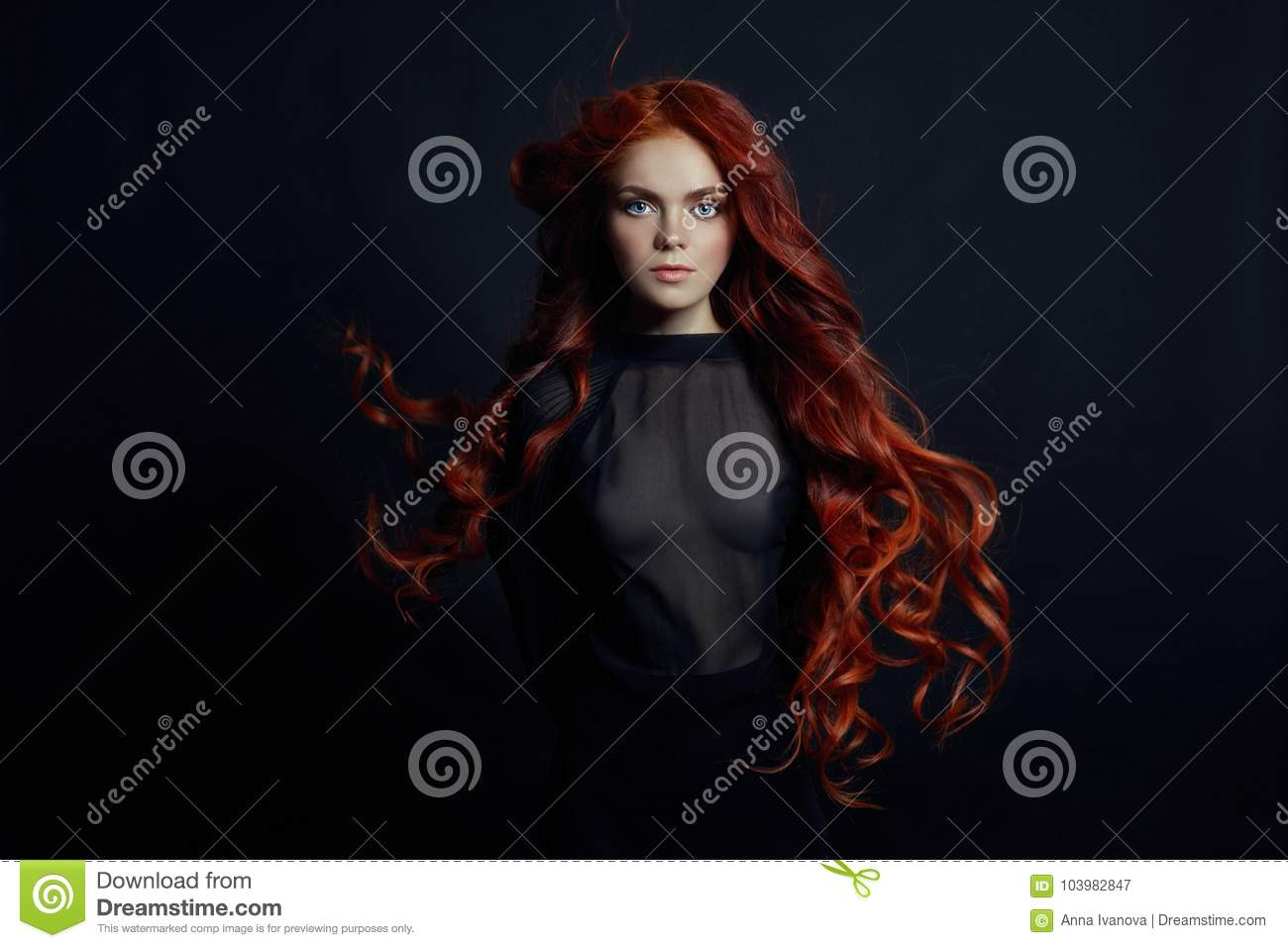 Portrait of redhead woman with long hair on black background. Perfect girl with the blue eyes, nice clean skin