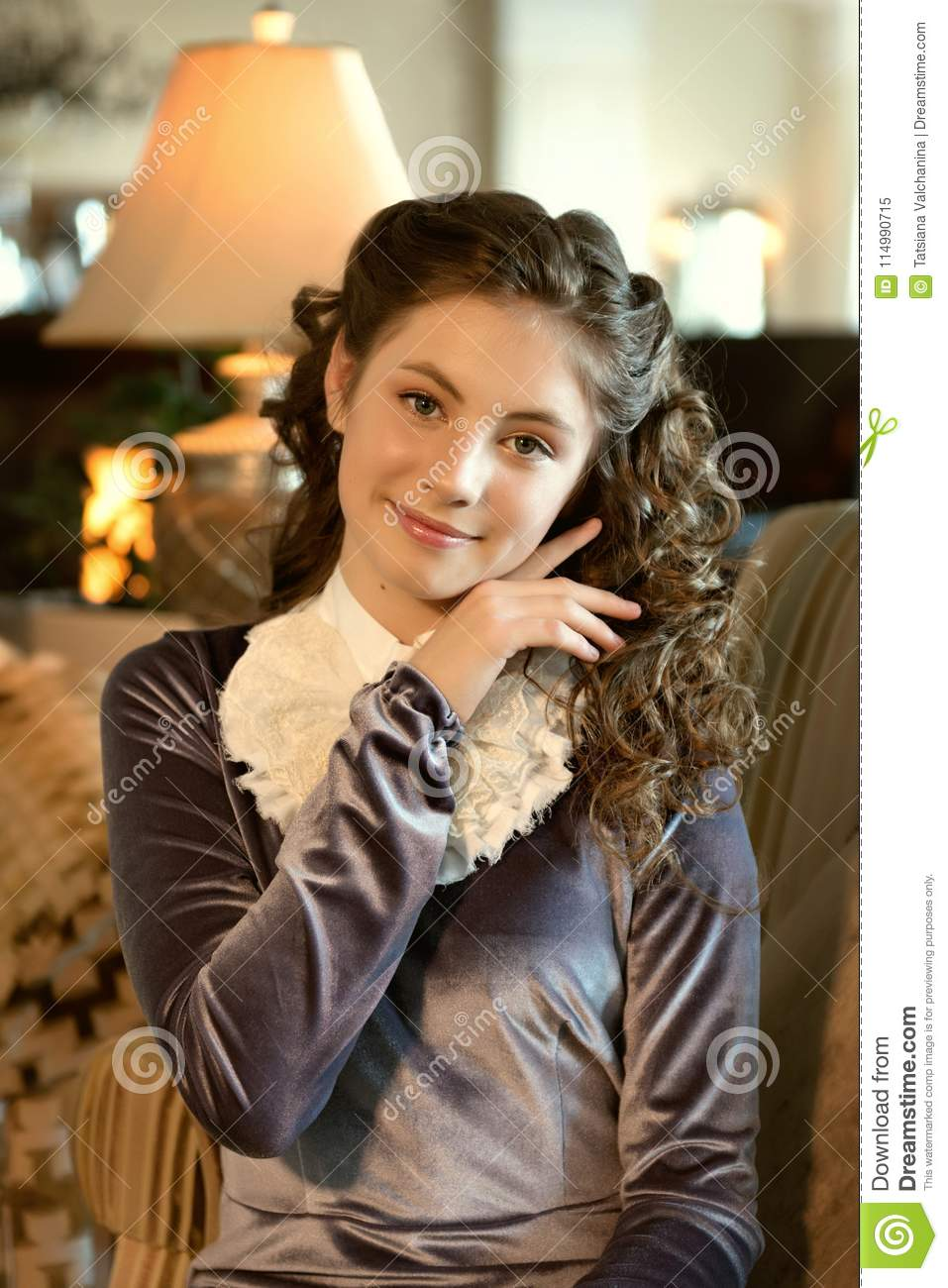 Portrait of a gentle romantic cute modest lady girl in vintage clothes