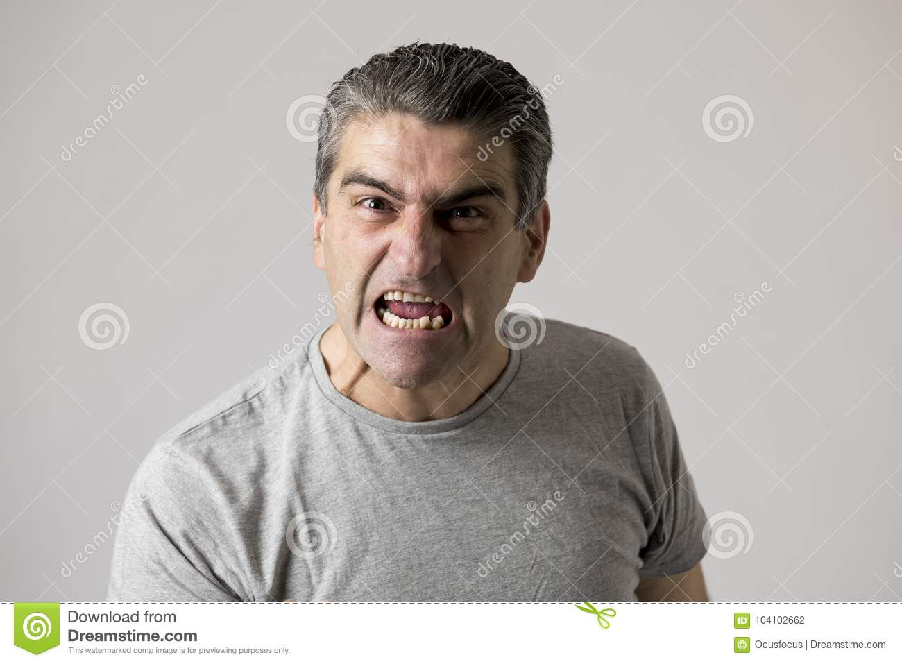 Portrait of 40s to 50s white angry and upset guy and crazy furious and aggressive face expression nagging and complaining