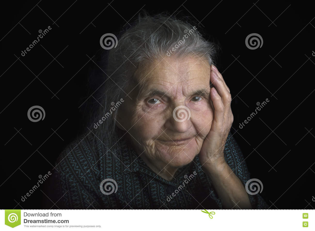 Portrait of a sad elderly woman. Dreaming the past.