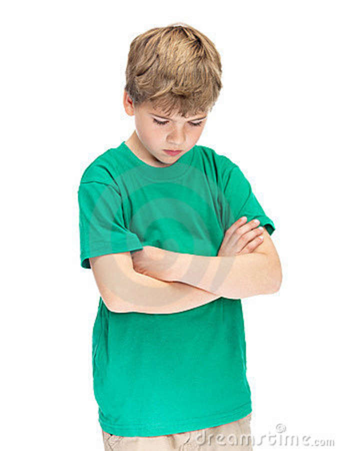 stock image portrait of a sad little boy standing with