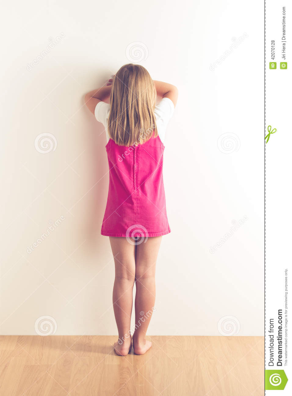 Portrait Of Sad Little Girl Standing Near Wall Stock Photo - Image ...