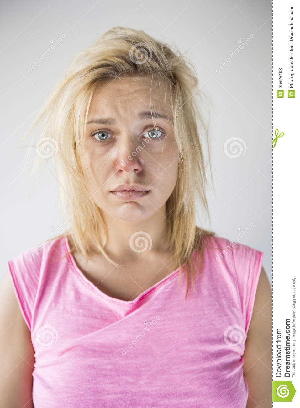 Portrait of sad woman suffering from cold against gray background