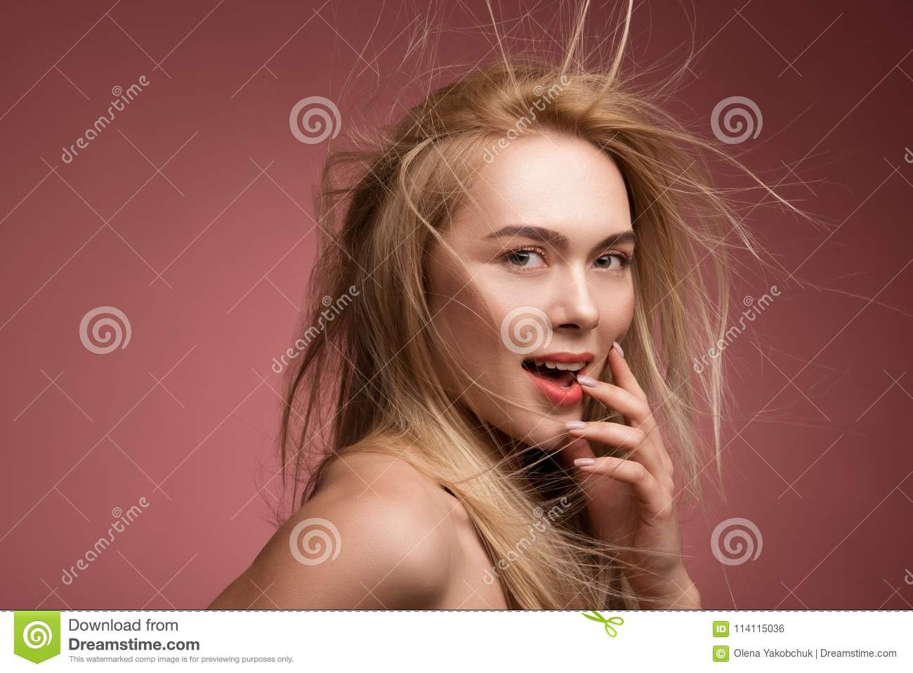 Coquettish lady with chaotic hairstyling
