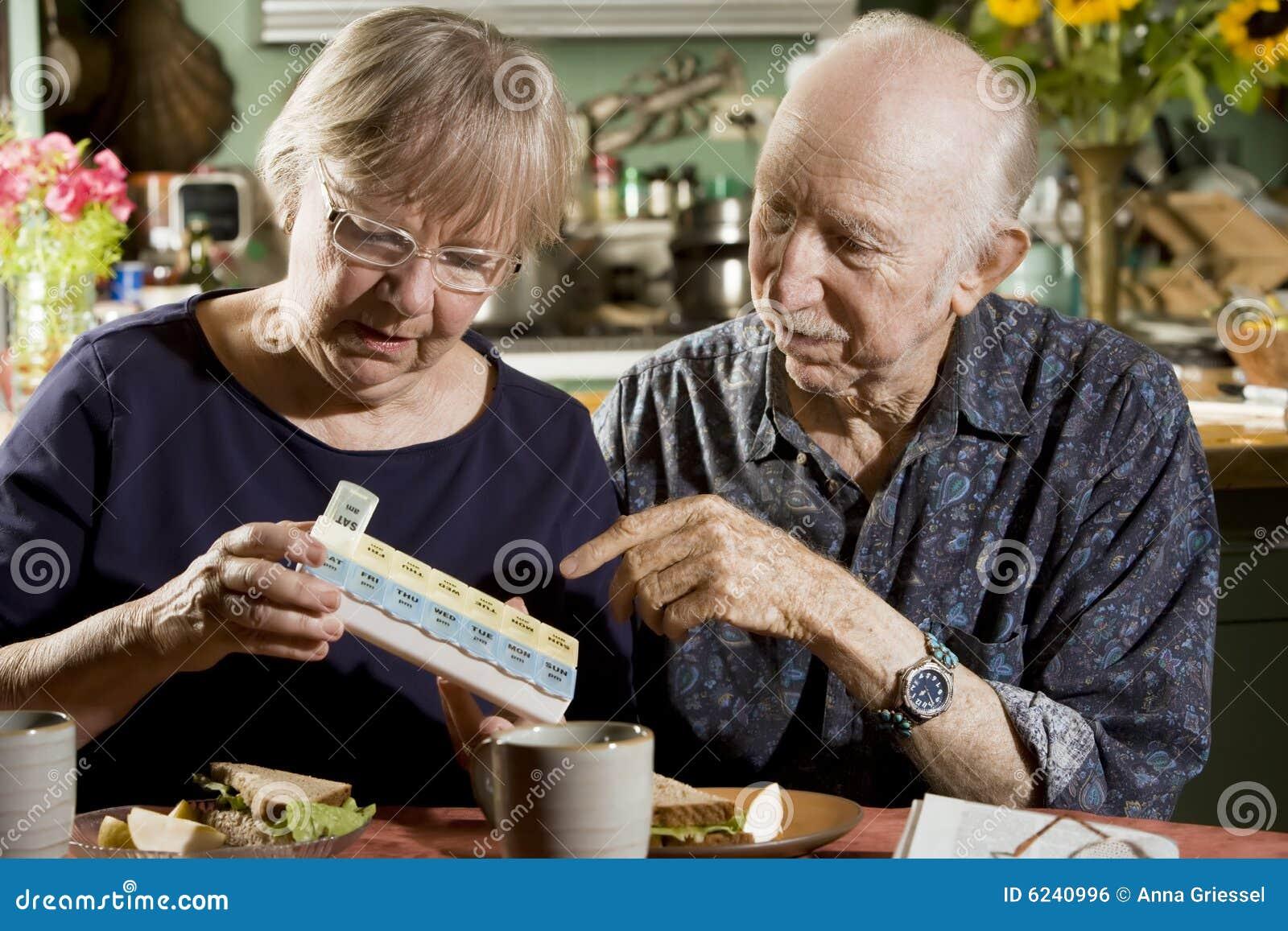 Portrait of Senior Couple with Pill Case