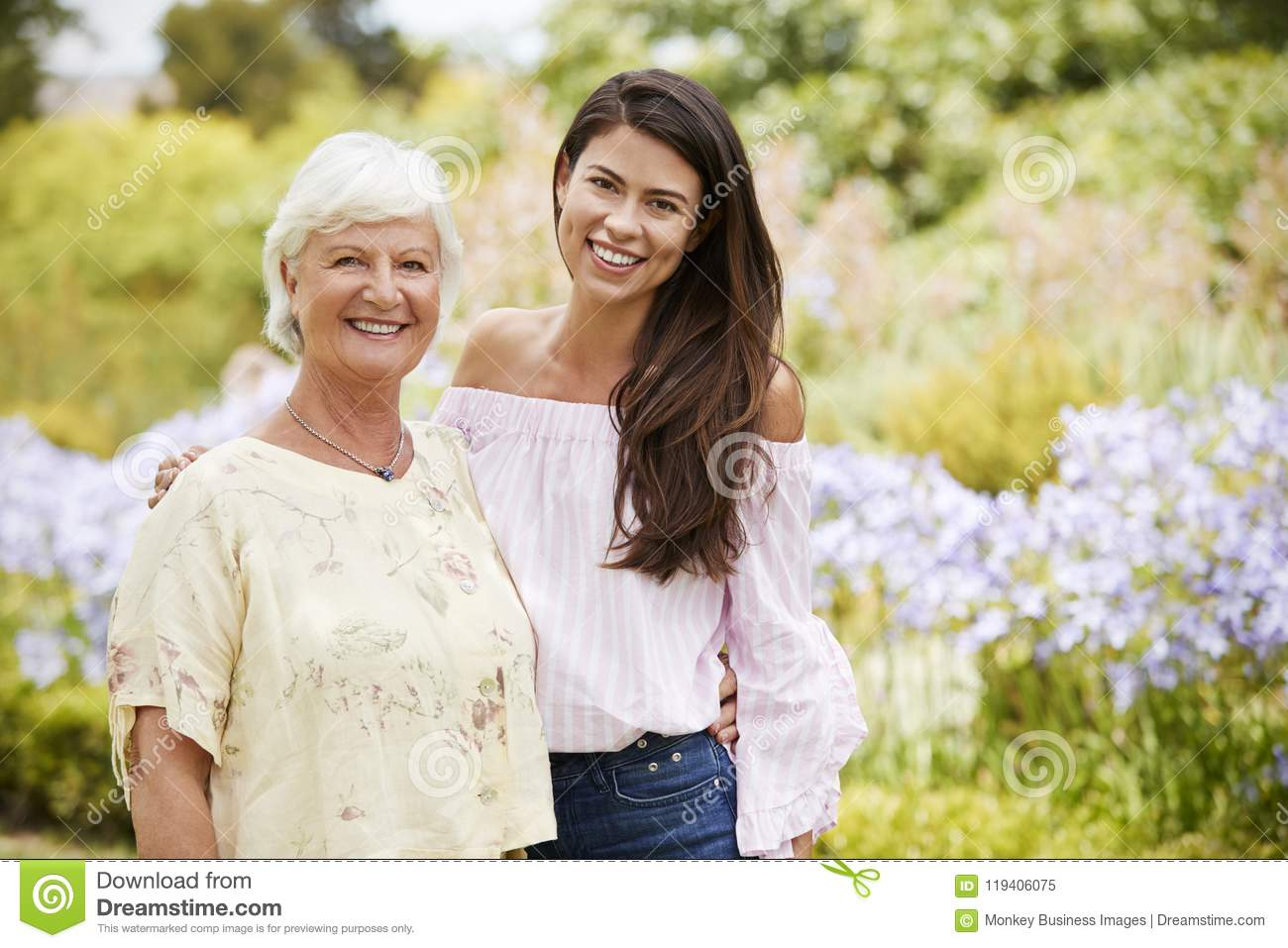 Portrait Of Senior Mother With Adult Daughter On Walk In Park