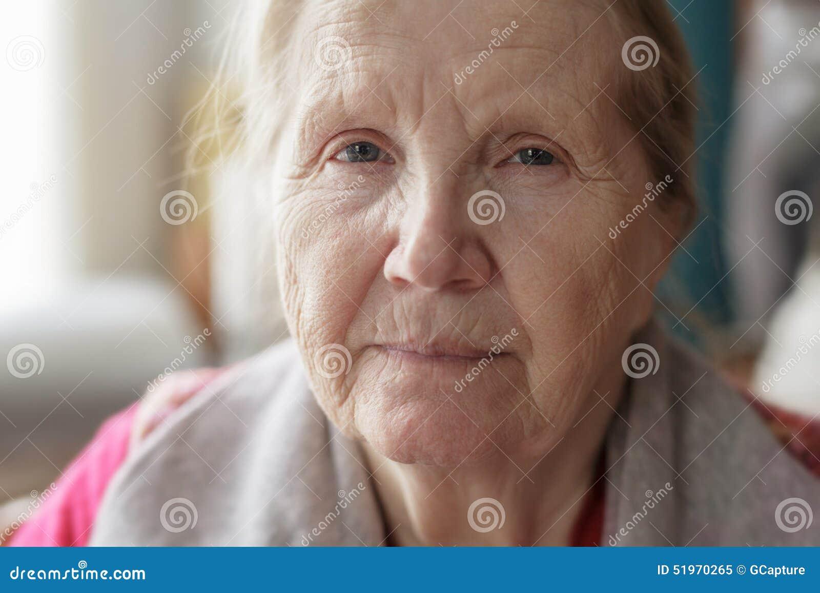 Portrait of senior woman siting near the window