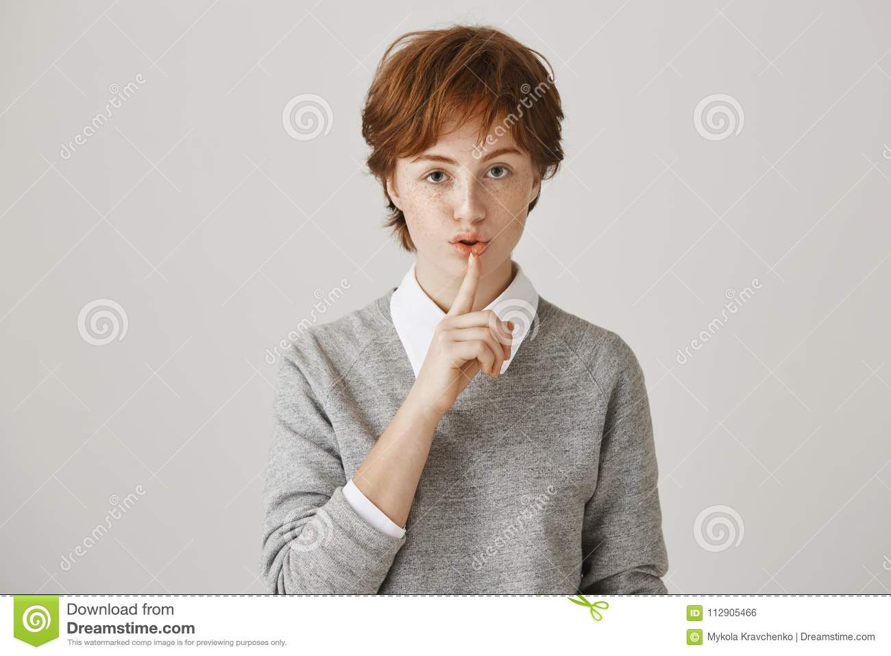 Portrait Of Serious Worried Redhead Woman With Short Messy Haircut And  Freckles Saying Shush While Holding Index Finger Stock Photo - Image of  happy, fashion: 112905466