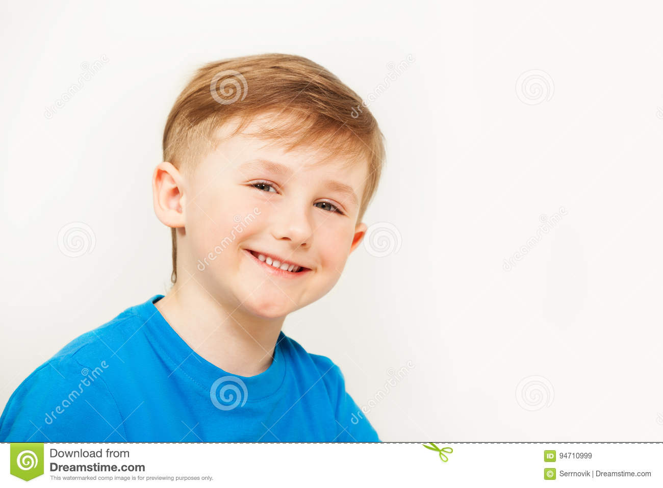 Portrait of seven years old boy in blue t-shirt